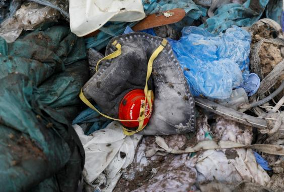 A discarded mask lies among other bits of disposed medical waste (Reuters)
