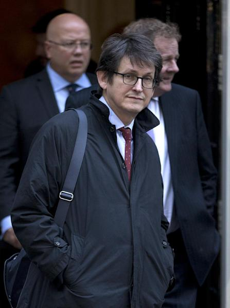 FILE - This is a Tuesday, Dec. 4, 2012 file photo of the editor of the Guardian newspaper Alan Rusbridger as he leaves Downing street after a meeting of fellow newspaper editors and the British Prime Minister David Cameron following the release of the Leveson media inquiry in London. The Guardian newspaper, which started publishing in the English city of Manchester in 1821 and is now based in London, has in the last two days established a major presence in Washington by uncovering the vast scope of secret surveillance operations carried out by U.S. officials. The revelations have put President Barack Obama and his national security team on the defensive with reports of government snooping on a comprehensive scale. Its coverage expanded to Britain on Friday June 7, 2013 with an exclusive report that Britain's electronic surveillance agency has had access to data collected by the Americans. (AP Photo/Alastair Grant, File)