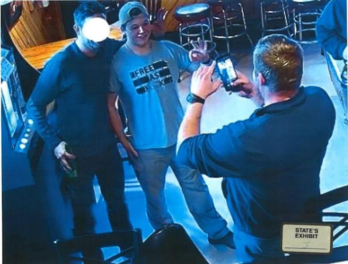 Kenosha shooting suspect Kyle Rittenhouse is seen in Pudgy's Pub in Mount Pleasant on Jan. 5 posing for a photo while flashing a white power sign.