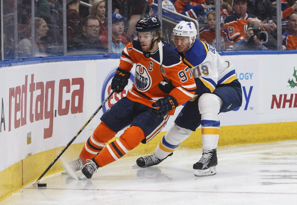 St. Louis Blues' Jay Bouwmeester (19) defends against Edmonton Oilers' Connor McDavid (97) during second period NHL hockey action in Edmonton, Alberta, on Tuesday, Dec. 18, 2018. (Jason Franson/The Canadian Press via AP)