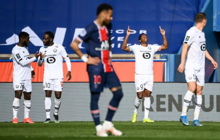 Lille forward Jonathan David (2R) celebrates after scoring his team's winner against Ligue 1 title rivals PSG last weekend