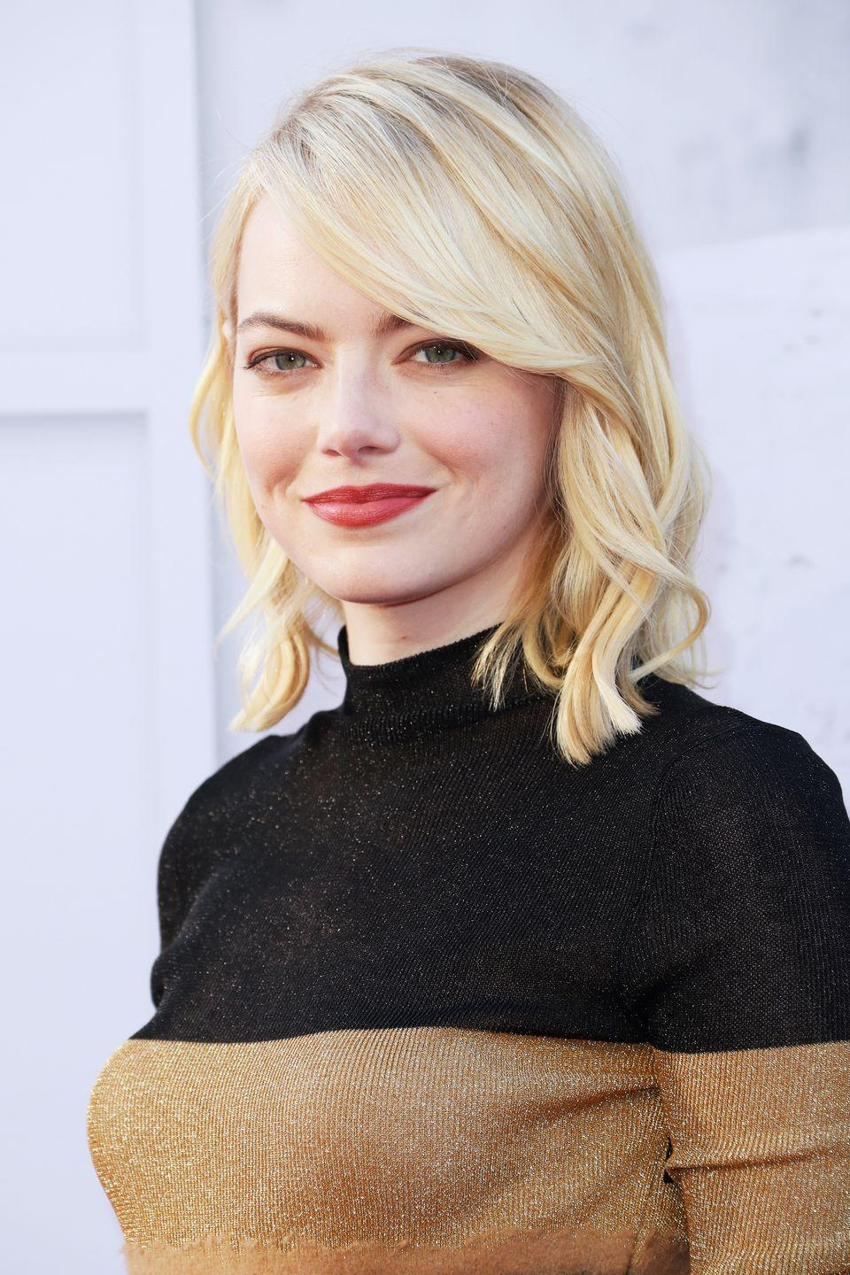 <p>Emma Stone knows how to wear a side-swept lob so well. The fact that her bangs fall heavier on one side takes attention away from symmetrical features of found faces, and draws more attention to elongate her chin. </p>