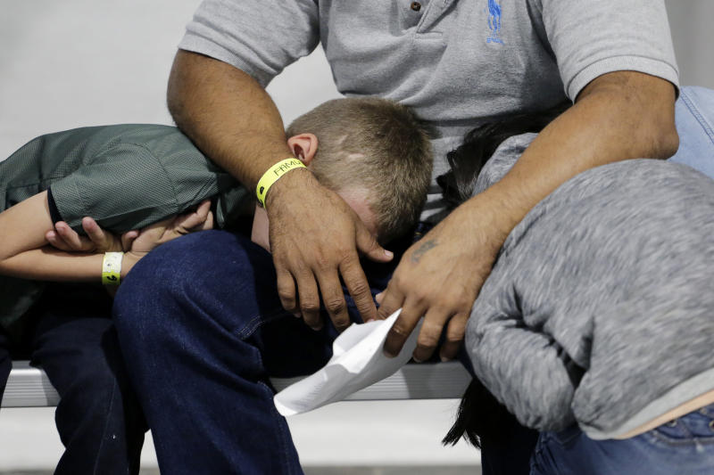 Migrants who are applying for asylum in the United States wait in a holding area at a new tent courtroom at the Migration Protection Protocols Immigration Hearing Facility, Sept. 17, 2019, in Laredo, Texas. (Photo: Eric Gay/AP)