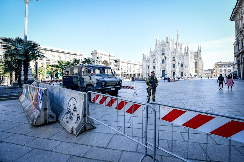 An armed guard outside the closed off Duomo di Milano . Source: Getty