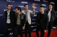 <p>The Canadian rockers got the party started on the red carpet, sporting their own custom Arkells bomber jacket! </p>