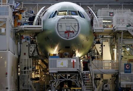 An Airbus A330neo is pictured on its final assembly line at Airbus headquarters in Colomiers, near Toulouse