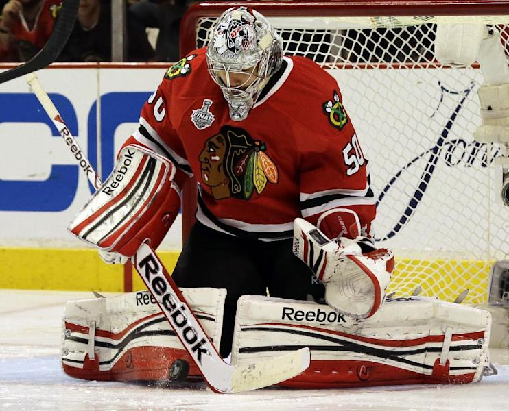 Chicago Blackhawks goalie Corey Crawford (50) makes a save during the second overtime period of Game 1 in their NHL Stanley Cup Final hockey series against the Boston Bruins, Wednesday, June 12, 2013, in Chicago. (AP Photo/Nam Y. Huh)