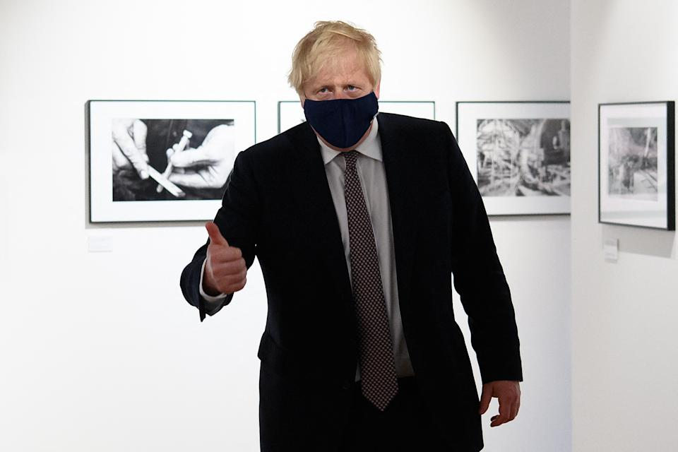 Britain's Prime Minister Boris Johnson makes a thumbs-up gesture reacts during a visit to Falmouth's Maritime Museum, where he met and thanked volunteers hosting the media centre for the G7 Summit, in Falmouth, Cornwall on June 10, 2021, ahead of the three-day G7 summit being held from 11-13 June. - G7 leaders from Canada, France, Germany, Italy, Japan, the UK and the United States meet this weekend for the first time in nearly two years, for the three-day talks in Carbis Bay, Cornwall. - (Photo by Leon Neal / POOL / AFP) (Photo by LEON NEAL/POOL/AFP via Getty Images)