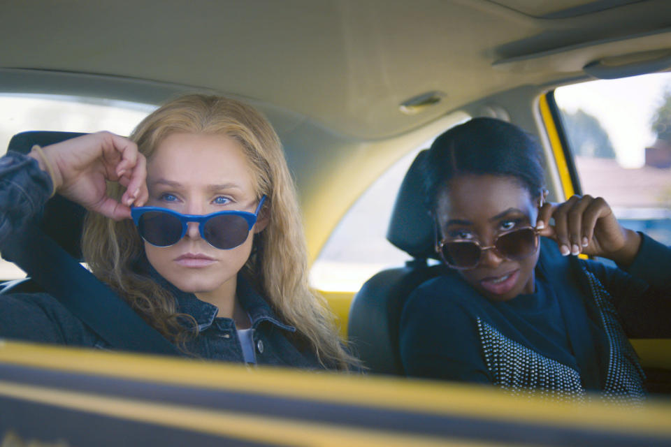 """This image released by STX Films shows Kristen Bell, left, and Kirby Howell-Baptiste in a scene from """"Queenpins."""" (STX Films via AP)"""