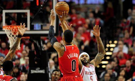 Feb 25, 2016; Portland, OR, USA; Portland Trail Blazers guard Damian Lillard (0) shoots the ball over Houston Rockets center Josh Smith (5) during the first quarter of the game at the Moda Center at the Rose Quarter. Mandatory Credit: Steve Dykes-USA TODAY Sports