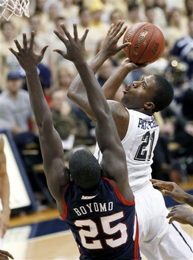 Pittsburgh's Lamar Patterson (21) shoots over Howard's Theodore Boyomo (25) during the first half of an NCAA college basketball game Tuesday, Nov. 27, 2012, in Pittsburgh. (AP Photo/Keith Srakocic)