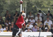 New Orleans Saints quarterback Jameis Winston (2) throws as fans watch practice from stands during NFL football training camp in Metairie, La., Saturday, July 31, 2021. (AP Photo/Derick Hingle)