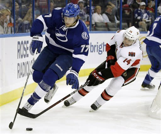Tampa Bay Lightning defenseman Victor Hedman (77), of Sweden, skates away from Ottawa Senators left wing Colin Greening (14) during the first period of an NHL hockey game, Tuesday Feb. 14, 2012, in Tampa, Fla. (AP Photo/Chris O'Meara)