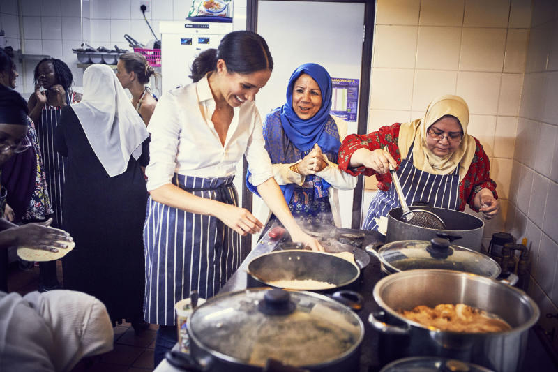 Meghan cooking with the women at the Hubb Community Kitchen. She began volunteering there in January 2018, just a few months after moving to London. (PA Wire/PA Images)