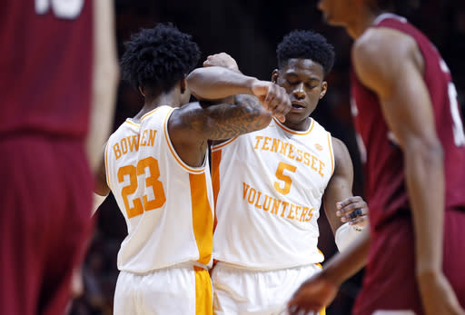 Tennessee guard Admiral Schofield (5) is congratulate by guard Jordan Bowden (23) after being fouled during the second half of an NCAA college basketball game against the South Carolina Wednesday, Feb. 13, 2019, in Knoxville, Tenn. Tennessee won 85-73. (AP photo/Wade Payne)