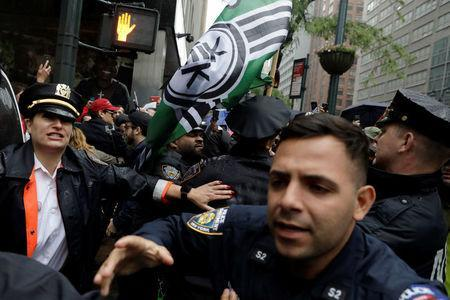 New York City Police officers (NYPD) and demonstrators clash during a protest against CUNY commencement speaker Linda Sarsour, former executive director of the Arab American Association, in New York City, U.S., May 25, 2017. REUTERS/Lucas Jackson