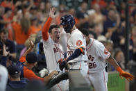 Houston Astros' Chas McCormick (20) is congratulated by Alex Bregman, left, and Jose Siri (26) after hitting a home run against the Arizona Diamondbacks during the eighth inning of a baseball game Sunday, Sept. 19, 2021, in Houston. (AP Photo/David J. Phillip)
