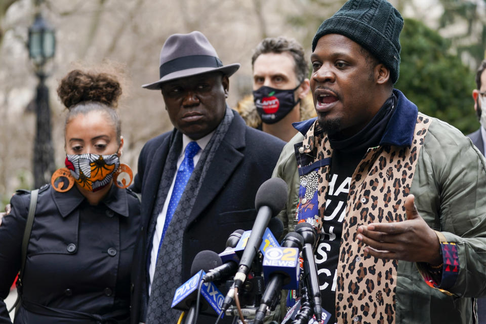 Keyon Harrold Sr., left, is joined by attorney Ben Crump, center, and Katty Rodriguez as he speaks to reporters during a news conference to announce the filing of a lawsuit against Arlo Hotels and Miya Ponsetto, Wednesday, March 24, 2021, in New York. Keyon Harrold and his son were allegedly racially profiled in an Arlo hotel in Manhattan by Miya Ponsetto in December 2020. Ponsetto wrongly accused Keyon Harrold Jr. of stealing her phone and physically attacking him. (AP Photo/Mary Altaffer)