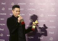 """Singaporean director Anthony Chen celebrates winning the Best New Director and Best Original Screenplay for """"Ilo Ilo"""" at the 50th Golden Horse Film Awards in Taipei November 23, 2013. REUTERS/Patrick Lin (TAIWAN - Tags: ENTERTAINMENT)"""