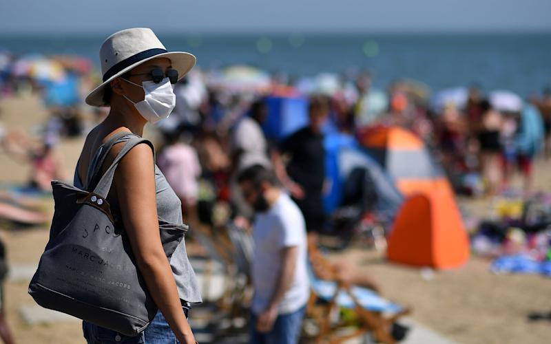 woman wearing face mask - Getty