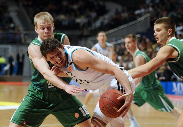 Real Madrid's Montenegrin forward Nikola Mirotic (C) vies with Olimpija Ljubljana's Finnish forward Sasu Salin (L) during the Euroleague Group A basketball match Real Madrid vs Union Olimpija Ljubljana at the Sports Palace in Madrid on December 13, 2012. AFP PHOTO / PEDRO ARMESTREPEDRO ARMESTRE/AFP/Getty Images
