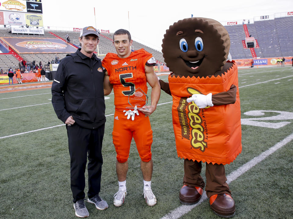 Senior Bowl executive director Jim Nagy, left, has done a great job in his one year with the pre-NFL draft event held each January in Mobile, Ala. (Getty Images)