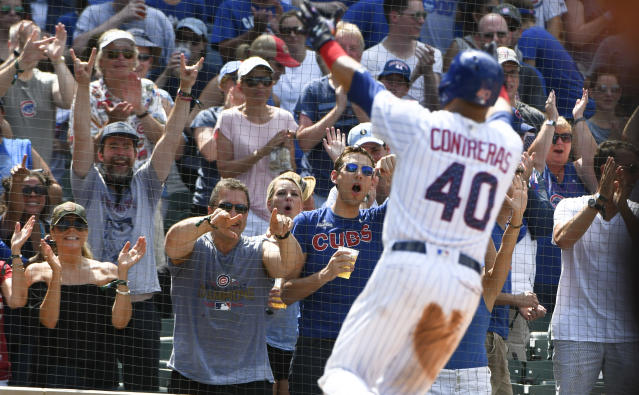 Chicago Cubs' Willson Contreras (40) points to fans after his home run during the sixth inning of a baseball game against the Detroit Tigers on Wednesday, July 4, 2018, in Chicago. (AP Photo/Matt Marton)