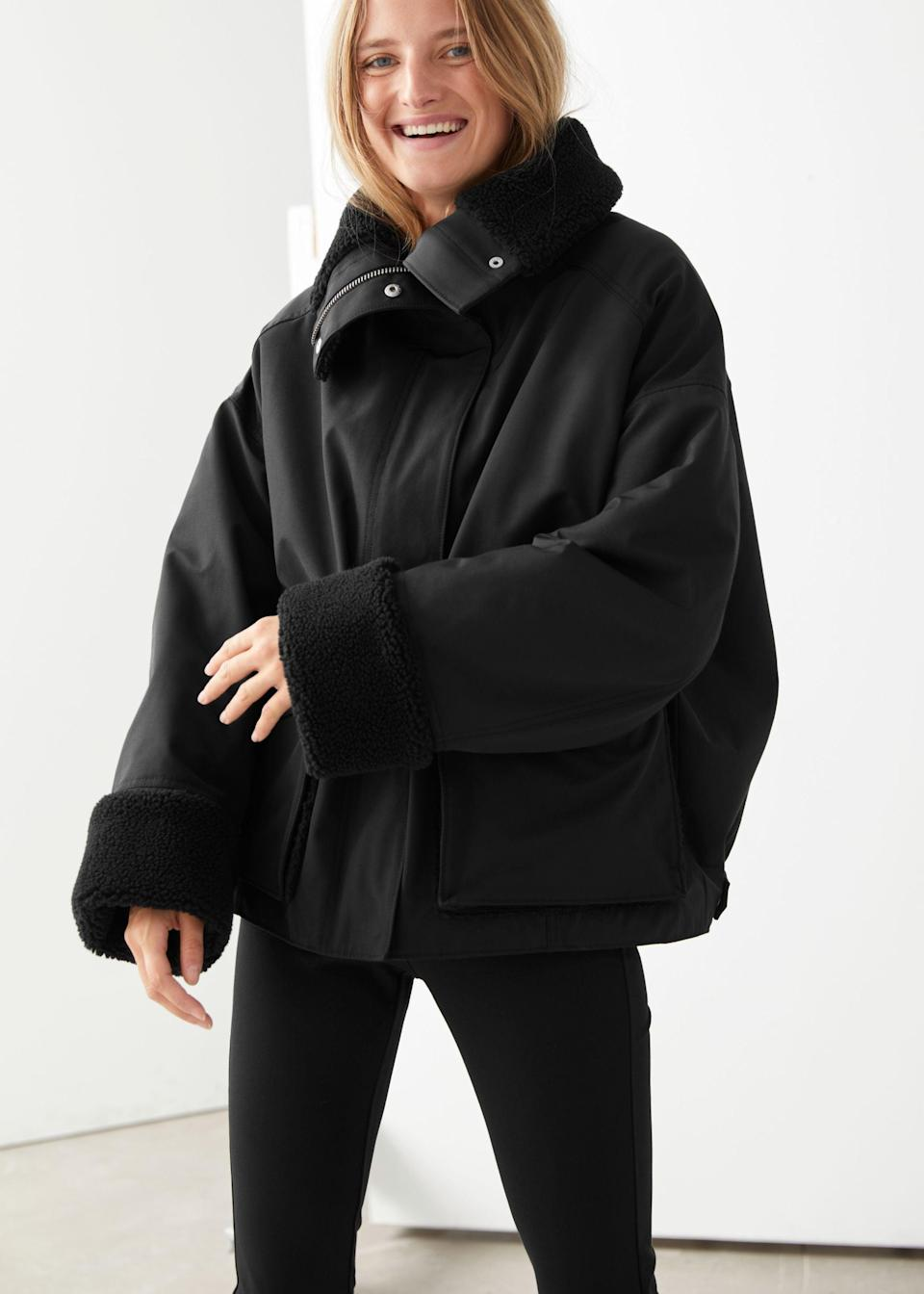"<br><br><strong>& Other Stories</strong> Short Oversized Puffer Jacket, $, available at <a href=""https://go.skimresources.com/?id=30283X879131&url=https%3A%2F%2Fwww.stories.com%2Fen_usd%2Fclothing%2Fjackets-coats%2Fjackets%2Fproduct.oversized-boxy-shearling-jacket-black.0878973001.html"" rel=""nofollow noopener"" target=""_blank"" data-ylk=""slk:& Other Stories"" class=""link rapid-noclick-resp"">& Other Stories</a>"