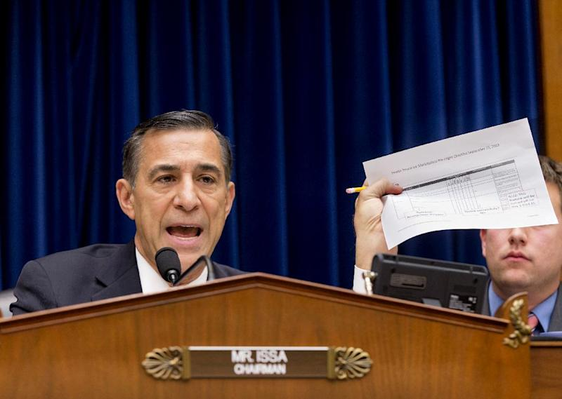 "FILE - In this Nov. 13, 2013 file photo, House Oversight Committee Chairman Rep. Darrell Issa, R-Calif., holds up a checklist related to the preparation for the implementation of the Obamacare healthcare program, and specifically, the HealthCare.gov website, on Capitol Hill in Washington. For two months, the talk was all about computer code. About response times. About glitches and bugs. Issa, who misses no opportunity to investigate perceived shortcomings in the health care program, devoted a full hearing to the ""limitations of Big Government"" when it comes to health care. (AP Photo/J. Scott Applewhite, File)"