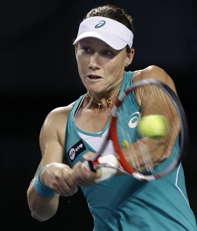 Samantha Stosur of Australia returns a shot against Lucie Safarova of the Czech Republic during their third round match of the Pan Pacific Open tennis tournament in Tokyo, Wednesday, Sept. 25, 2013. (AP Photo/Shizuo Kambayashi)