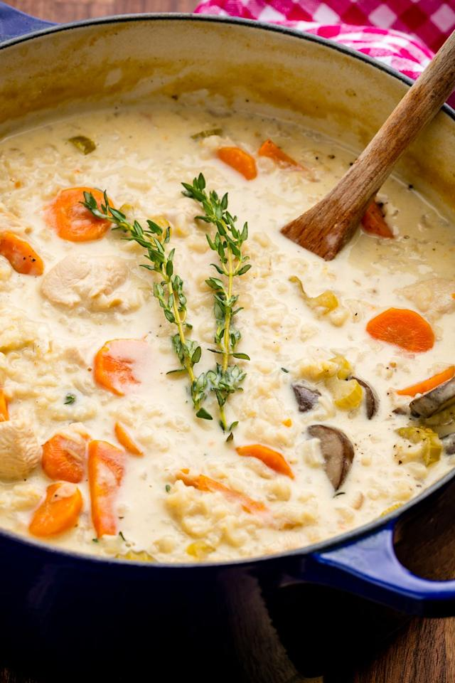 """<p>If you aren't making creamy soups when the weather cools down, you're missing the point of autumn.</p><p>Get the recipe from <a href=""""https://www.delish.com/cooking/recipe-ideas/recipes/a49376/creamy-chicken-mushroom-soup-recipe/"""" target=""""_blank"""">Delish</a>.</p>"""