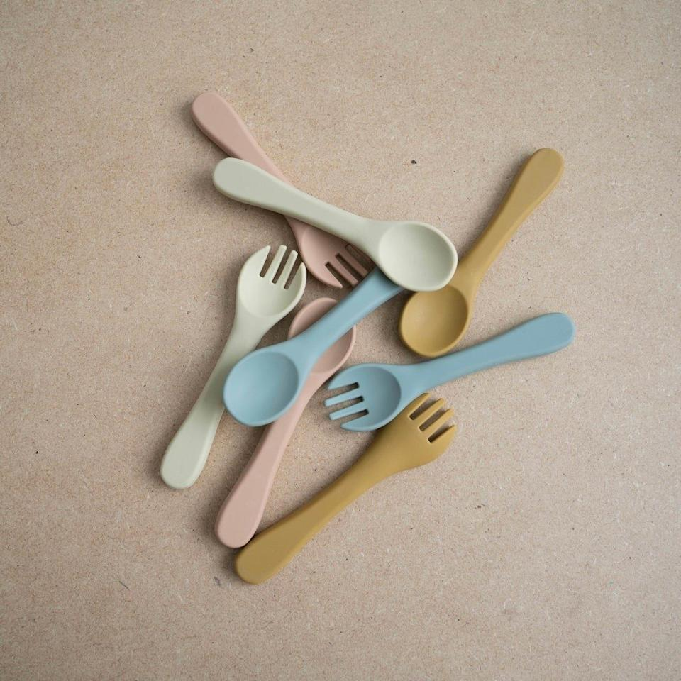 """With soft edges and perfect dimensions for tiny hands, these utensils might seem soft to the touch, but they are strong enough for toddlers to actually puncture and pick up food. They're also dishwasher-safe —the dream. (BTW, this woman-owned company is based in Los Angeles.)<br /><br /><strong>Promising review:</strong>""""I am completely in love! These are good quality and I love the color."""" — Paola Linares<br /><br /><strong>Get it from<a href=""""https://go.skimresources.com?id=38395X987171&xs=1&url=https%3A%2F%2Fwww.etsy.com%2Fshop%2FChlomiBaby&xcust=HPToddlerMealtime60885fbae4b0ccb91c2ac430"""" target=""""_blank"""" rel=""""noopener noreferrer"""">Chlomi Baby</a>on Etsy for<a href=""""https://go.skimresources.com?id=38395X987171&xs=1&url=https%3A%2F%2Fwww.etsy.com%2Flisting%2F886039651%2Fsilicone-baby-toddler-training-utensils&xcust=HPToddlerMealtime60885fbae4b0ccb91c2ac430"""" target=""""_blank"""" rel=""""noopener noreferrer"""">$9</a>(available in four colors).</strong>"""