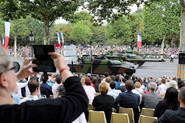 <p>People watch Leclerc main battle tanks during the military parade during Bastille Day celebrations on Champs Elysees avenue in Paris on July 14, 2017. (Photo: Ludovic Marin/AFP/Getty Images) </p>