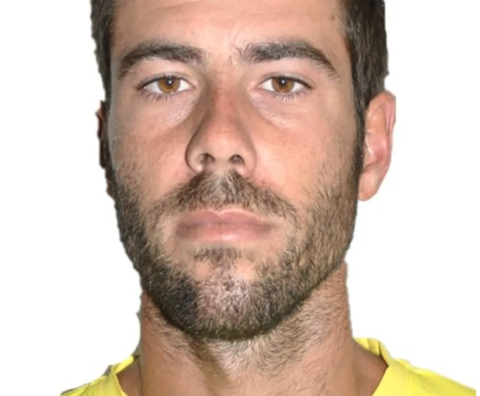 Tomas Gimeno wears a yellow shirt against a white background.