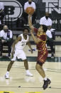 Iowa State guard Rasir Bolton (45) attempts a shot as Baylor guard Adam Flagler (10) looks on in the first half of an NCAA college basketball game, Tuesday, Feb. 23, 2021, in Waco, Texas. (AP Photo/Jerry Larson)