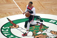 Washington Wizards guard Russell Westbrook dribbles the ball against the Boston Celtics during the first half of an NBA basketball Eastern Conference Play-in game, Tuesday, May 18, 2021, in Boston. (AP Photo/Charles Krupa)