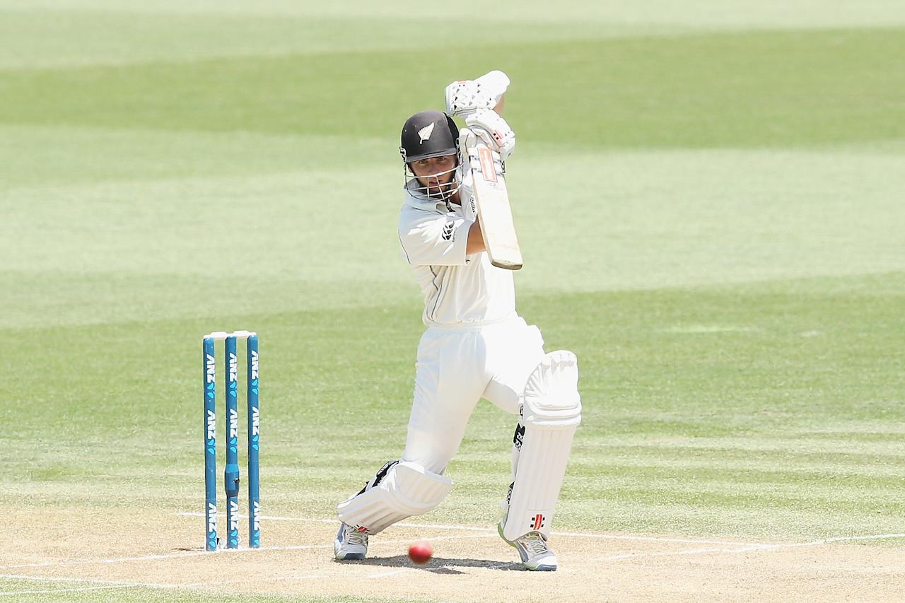 HAMILTON, NEW ZEALAND - DECEMBER 20: Kane Williamson of New Zealand drives the ball away during day two of the Third Test match between New Zealand and the West Indies at Seddon Park on December 20, 2013 in Hamilton, New Zealand.  (Photo by Hannah Johnston/Getty Images)