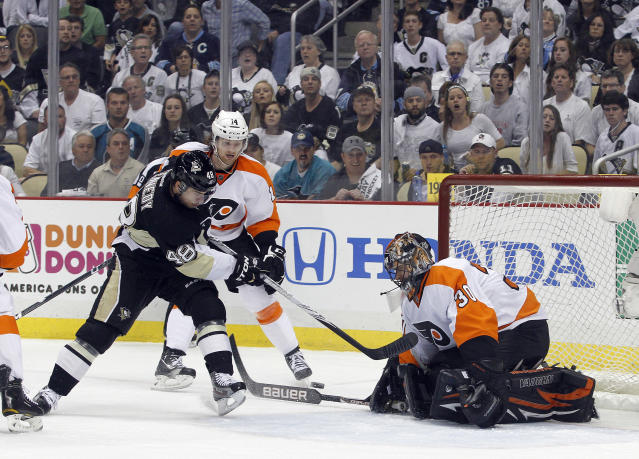 PITTSBURGH, PA - APRIL 20: Ilya Bryzgalov #30 of the Philadelphia Flyers makes a save on Tyler Kennedy #48 of the Pittsburgh Penguins in Game Five of the Eastern Conference Quarterfinals during the 2012 NHL Stanley Cup Playoffs at Consol Energy Center on April 20, 2012 in Pittsburgh, Pennsylvania. (Photo by Justin K. Aller/Getty Images)