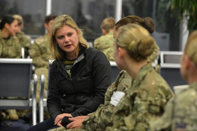 Picture released by Britain's Ministry of Defence shows International Development Secretary Justine Greening talking to medics at RAF Brize Norton in central England on October 21, 2014, prior to flying to Sierra Leone (AFP Photo/Cpl. Richard Cave)