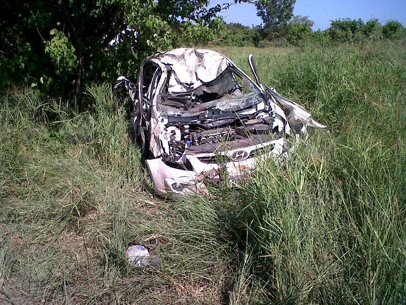 In this image made available by South African National Parks, a car that was overturned by an elephant lies on the side of the road in the Kruger National Park, Monday April 15, 2013.  A medical team in a helicopter rushed to help the injured male driver, who was taken to a hospital for further treatment. Park spokesman William Mabasa says it is unclear why the elephant became aggressive. (AP Photo/SAN Parks)