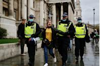LONDON, UNITED KINGDOM - OCTOBER 24: Police officers take into custody some protesters as members of StandUpX stage a protest against coronavirus (Covid-19) measures and vaccine in London, United Kingdom on October 24, 2020. (Photo by Hasan Esen/Anadolu Agency via Getty Images)