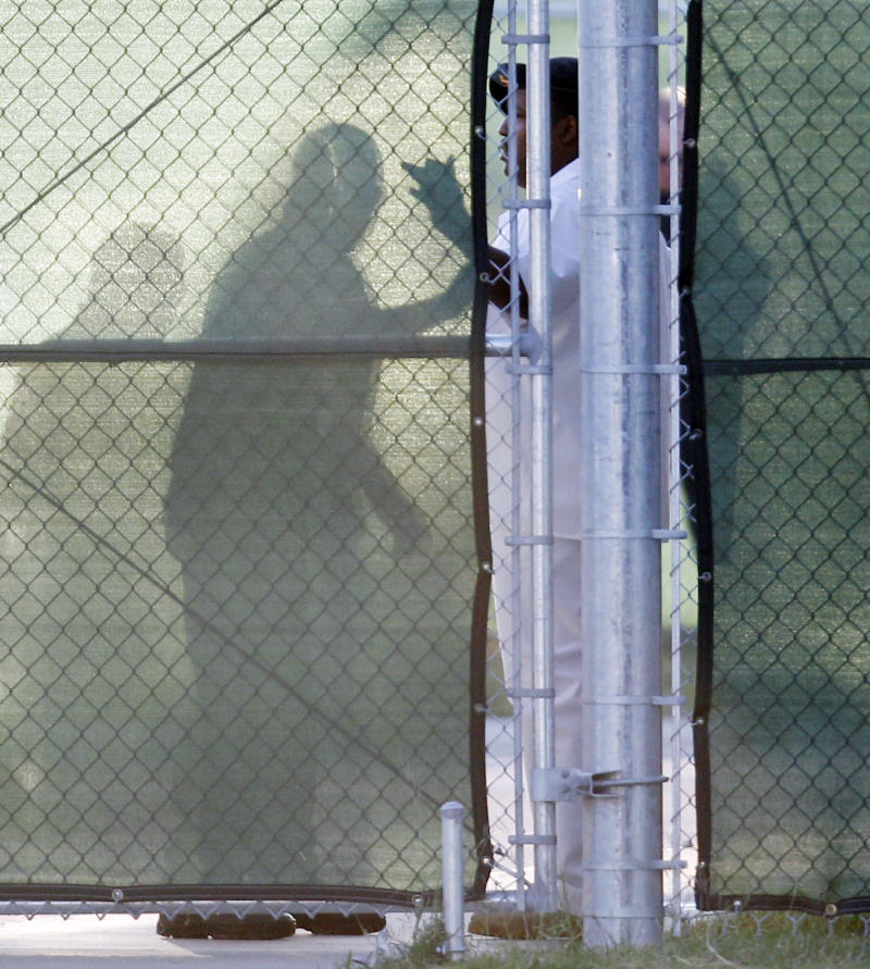 An unidentified man is checked by military personnel behind a security fence at the U.S. Magistrate court where an Article 32 hearing for Maj. Nidal Malik Hasan is scheduled to be held, Tuesday, Oct. 12, 2010, in Fort Hood, Texas. Hasan, 40, is charged with premeditated murder and attempted premeditated murder in a Nov. 5 attack , which killed 13 people and wounded 32 others in a processing center where soldiers were making final preparations to deploy. The Article 32 hearing will determine whether there is enough evidence to put the Army psychiatrist on trial. (AP Photo/Eric Gay)