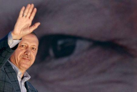 Turkey's Prime Minister Erdogan waves to the crowd in Istanbul