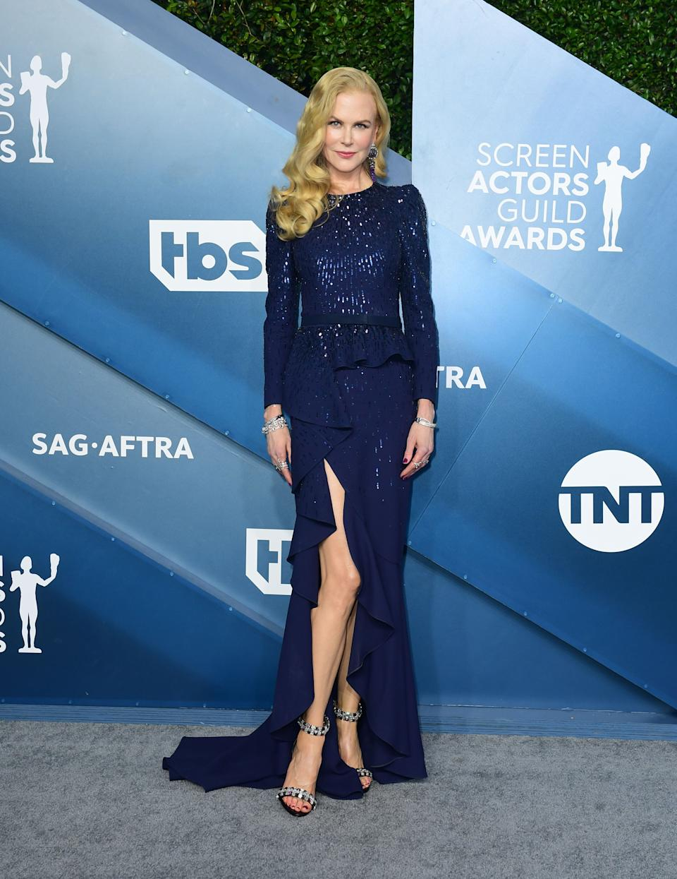 """The """"Big Little Lies"""" and """"Bombshell"""" star looked regal in navy Michael Kors with ruffled detail and thigh-high slit."""