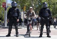Click on Next to see images of daily life in Spain and public demonstrations across the country over the past year, protesting against the government's spending cuts, labour market reforms, recession and overall economic crisis. (Image: Reuters)