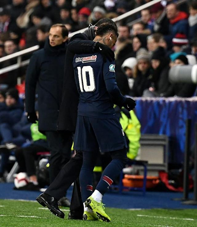 Neymar hobbling off the pitch in January with the injury that was to rule him out of the rest of PSG's ill-fated Champions League campaign (AFP Photo/FRANCK FIFE)