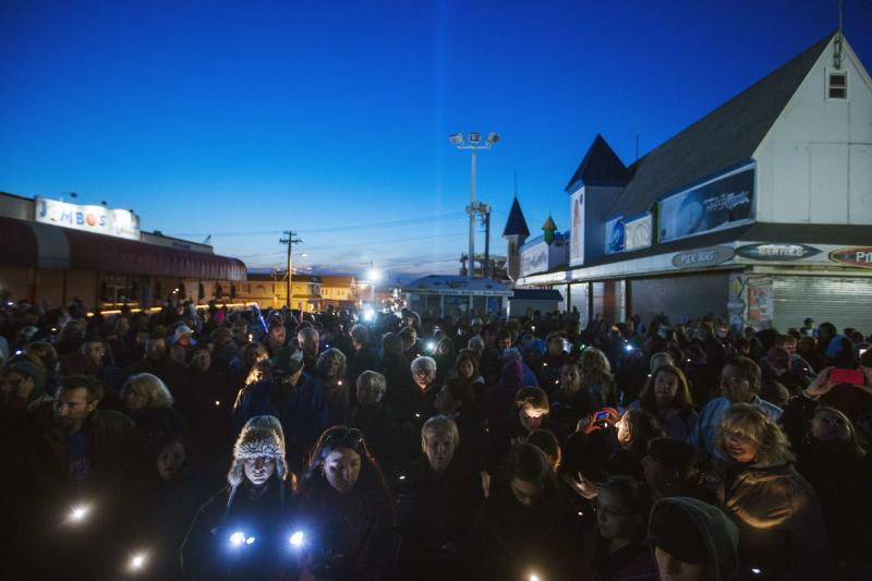 "Residents of New Jersey take part in a ""Light The Shore"" event on the one year anniversary of the landfall of Hurricane Sandy in Seaside Heights, New Jersey"
