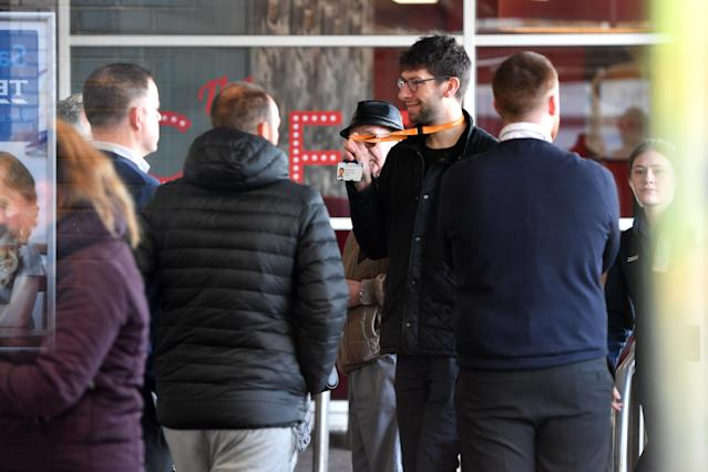 Tesco security staff check NHS identification badges as the supermarket opens an hour early for NHS staff in Wythenshawe, Manchester, on Sunday. (Getty Images)