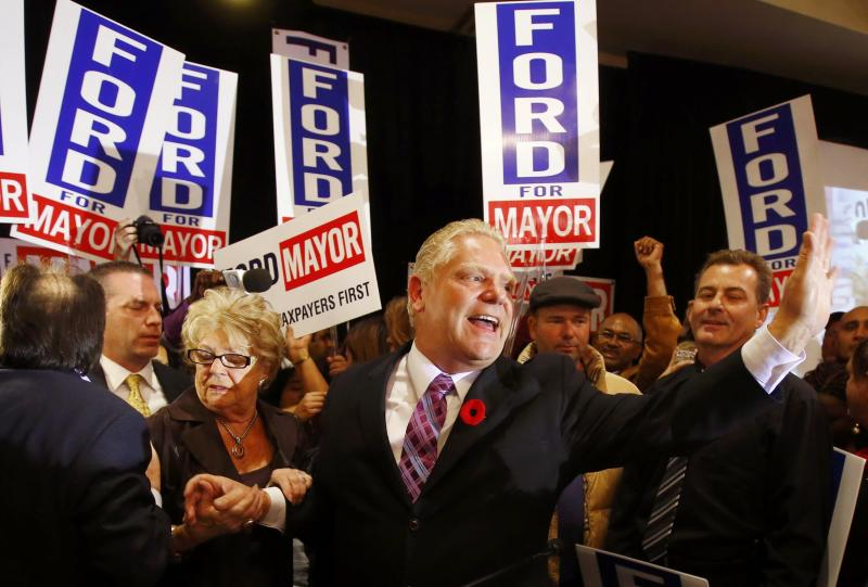 Doug Ford waves to supporters after failing to be elected as mayor in the municipal election in Toronto