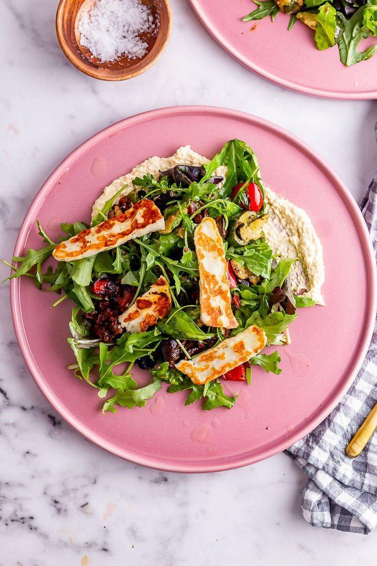 """<p>Fancy a healthy mix of fresh greens and chopped Mediterranean veggies marinated in a mixture of olive oil and lemon juice all served on a bed of hummus? Yes you do. </p><p>Get the <a href=""""https://thecookreport.co.uk/roast-vegetable-salad/"""" rel=""""nofollow noopener"""" target=""""_blank"""" data-ylk=""""slk:Roast Vegetable Salad with Halloumi"""" class=""""link rapid-noclick-resp"""">Roast Vegetable Salad with Halloumi</a> recipe.</p><p>Recipe from <a href=""""https://thecookreport.co.uk/"""" rel=""""nofollow noopener"""" target=""""_blank"""" data-ylk=""""slk:The Cook Report"""" class=""""link rapid-noclick-resp"""">The Cook Report</a>.</p>"""
